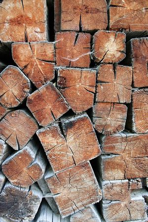 Pile of square logs, stacked to dry them for winter.  Stock Photo - 911613