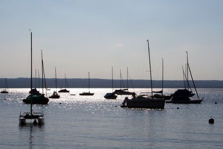 starnberger see: Boats in the evning on a lake in the Bavarian Alps.  Stock Photo