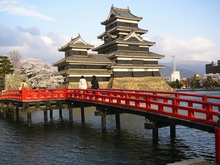 honshu: Matsumoto Castle in the Japanese Alps during Cherry Blossom (Sakura).