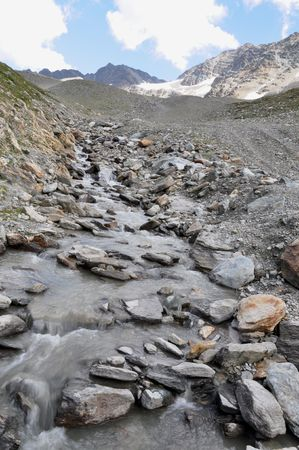 shrinking: A stream fed by the water of a glacier on Mt. Ortler in the Alps. The glaciers in the Alps are shrinking year by year. Evidence of Global Warming?