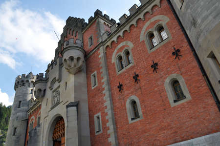 prototypical: Castle Neuschwanstein, the prototypical fairy-tale castle, is one of the most famous buildings in the world.  Stock Photo