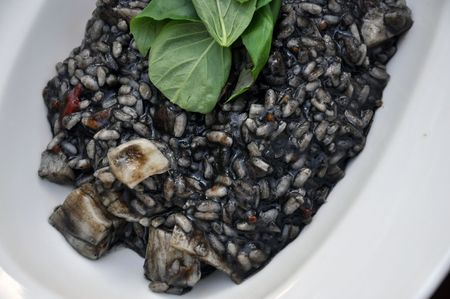 Black Risotto. The color comes from the ink of squids (calamarys) Stock Photo