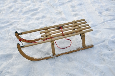 A traditional bavarian wooden sled in the snow