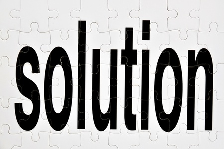Conceptual image depicting the word solution as a jigsaw puzzle photo