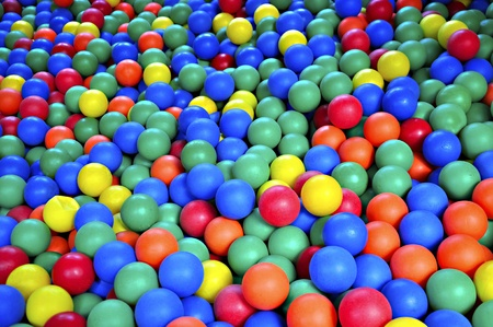pool balls: Ball pond filled with colorful, soft rubber balls.