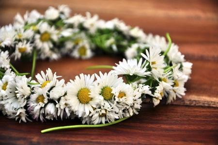 Wreath braided from daisies, a daisy chain Stock Photo