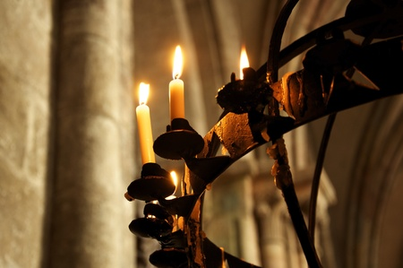 candelabra: Beautiful old iron chandelier hanging in an old gothic cathedral. A place for prayer or meditation.