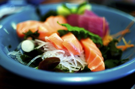 intentionally: Closeup of delicious salmon sashimi and slices of radish. Intentionally shallow depth of field Stock Photo