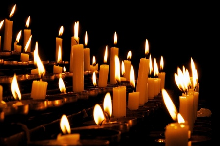 Burning prayer candles in a catholic church in Europe Stock Photo - 10576839