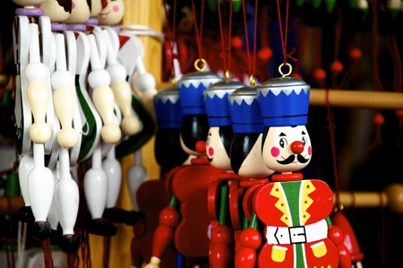 toy shop: Several different wooden Jumping Jacks hanging in an oldfashioned toy shop Stock Photo