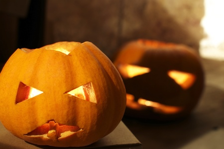 Two creepy jack-o-lanterns apporaching from the darkness Stock Photo - 10869775