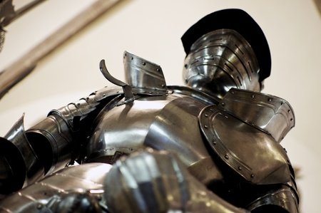 Powerful knight in iron armor seen from right below photo