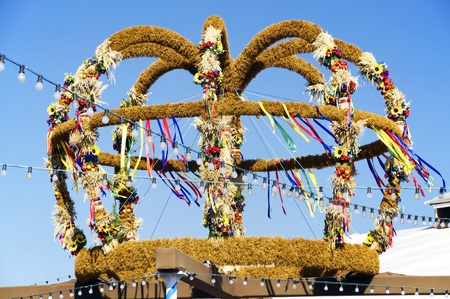 Large, decorated harvest crown on display at a fair in Bavaria, Germany. Harves Crowns are typical items for German Thanksgiving Stock Photo