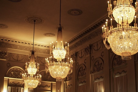 pompous: Festive or pompous room ceiling with large chandeliers Stock Photo