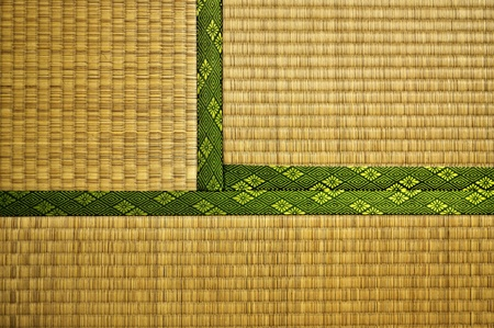 adjacent: Made from rice straw, Tatami Mats are the typical floor covering for traditional Japanese houses and temples. This image shows three adjacent Mats.  Stock Photo