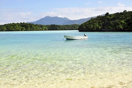 okinawa: Beautiful beach with small islands and a boat. Shot in Okinawa, Japan.