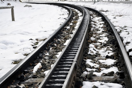 rack wheel: Tracks of a cog railway in the snow  This type of railway can climb even steep mountains