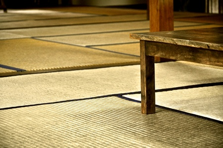 Traditional Japanese room covered with Tatami Mats and a flat wooden table Stock Photo