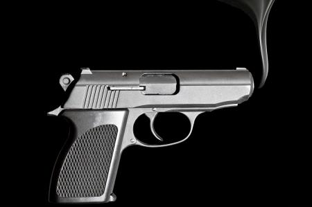 handgun: Handgun with smoke emerging from it