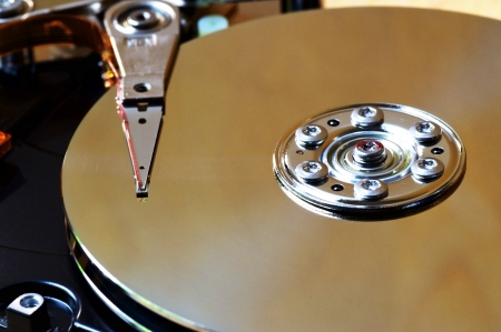 megabyte: Opened 3 5 inch harddisk  Information is stored magnetically on the spindles and written read by the head at the end of the actuator arm   Stock Photo
