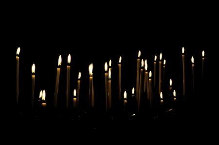 Candles in a dark room, giving the impression to float