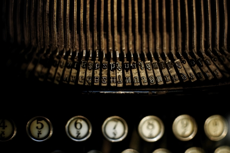 low light: Closeup of an old typewriters letter types. The language is czech. Selective Focus and low light.  Stock Photo