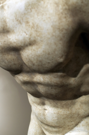 naked statue: Detail of an ancient marble statue of an athlete, depicting the concept of male body building