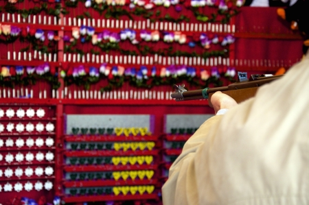 Air rifle being pointed for fun at a shooting gallery in a fair Stock Photo - 15770011
