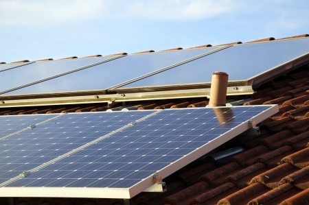Solar panels on the roof of a private house Stock Photo