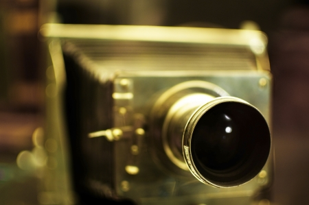 folding camera: Old folding camera made of brass  Selective Focus on the lens  Stock Photo