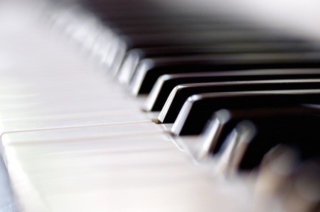 Closeup of a pianos black and white keys. Selective focus with shallow depth of field.  photo