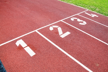 race track: Closeup of the numbers of a red race track, used for running Stock Photo