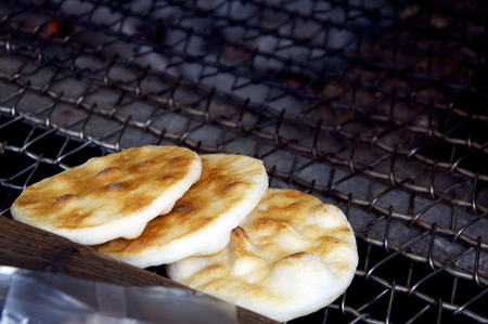 soysauce: Traditional Japanese Rise Cookie, Senbei or Sembei, being grilled over charcoal