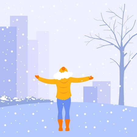 A girl in bright winter clothes stands against the backdrop of the city, holding out her hands to the falling snow. Snowfall