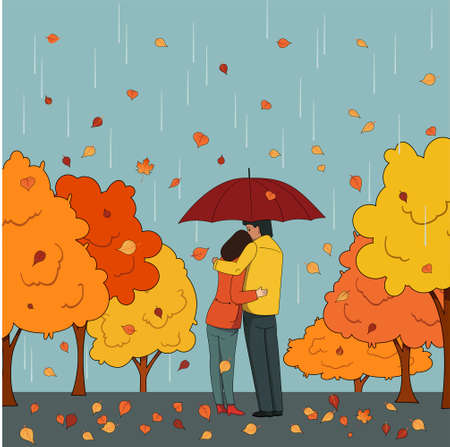 People, a man and a woman in autumn clothes are hugging under an umbrella against the background of autumn trees. Married couple. Lovers.
