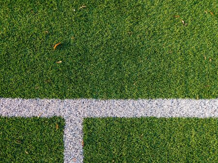 A close shot of white lines on a football field, American Football, Ruggby. Green grass.