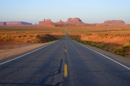 Long, straight road into Monument Valley,Utah photo