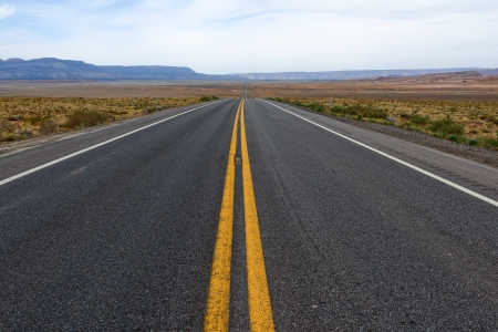 single lane road: Straight Desert highway in Arizona USA