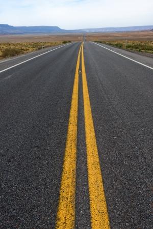 Straight Desert highway in Arizona USA photo