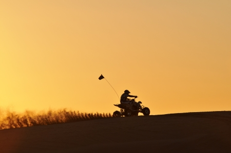 Quad-bike in Glamis sand Dunes during sunset Stock Photo