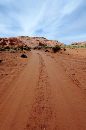 Dirt Road Through The Monument Valley photo