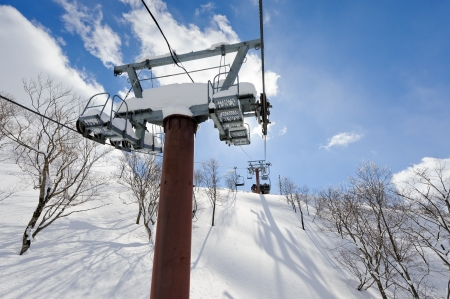 ski lift: Ski lift climbing through the snow forest. Stock Photo