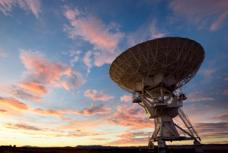 Radio telescope against dramatic sky at the National Radio Astronomy Observatory in Socorro, New Mexico photo