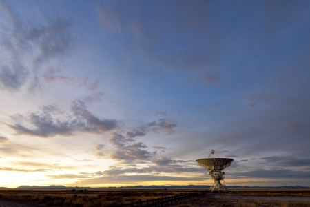 Radio telescope during sunset at the National Radio Astronomy Observatory in Socorro, New Mexico photo