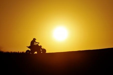 Quad-bike in Glamis sand Dunes during sunset Stock Photo