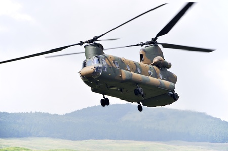 military invasion: Chinook CH-47, Tandem rotor military helicopter.