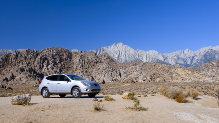 A SUV at Rocky desert in Eastern Sierra, California  photo