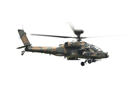 firepower: Apache attack helicopter on white background