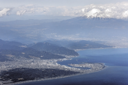 Aerial view of Mount Fuji from the sky above Suruga Bay