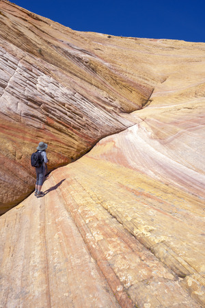 cottonwood canyon: A hiker at Yellow Rock, Grand Staircase-Escalante National Monument, Utah Stock Photo